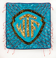 WTF Pillow by Rita Valley, aqua color, WTF in gold, pillow has red fringe